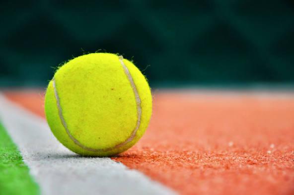 Tennis ball on a hardcourt
