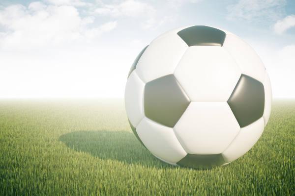Closeup of football on green grass